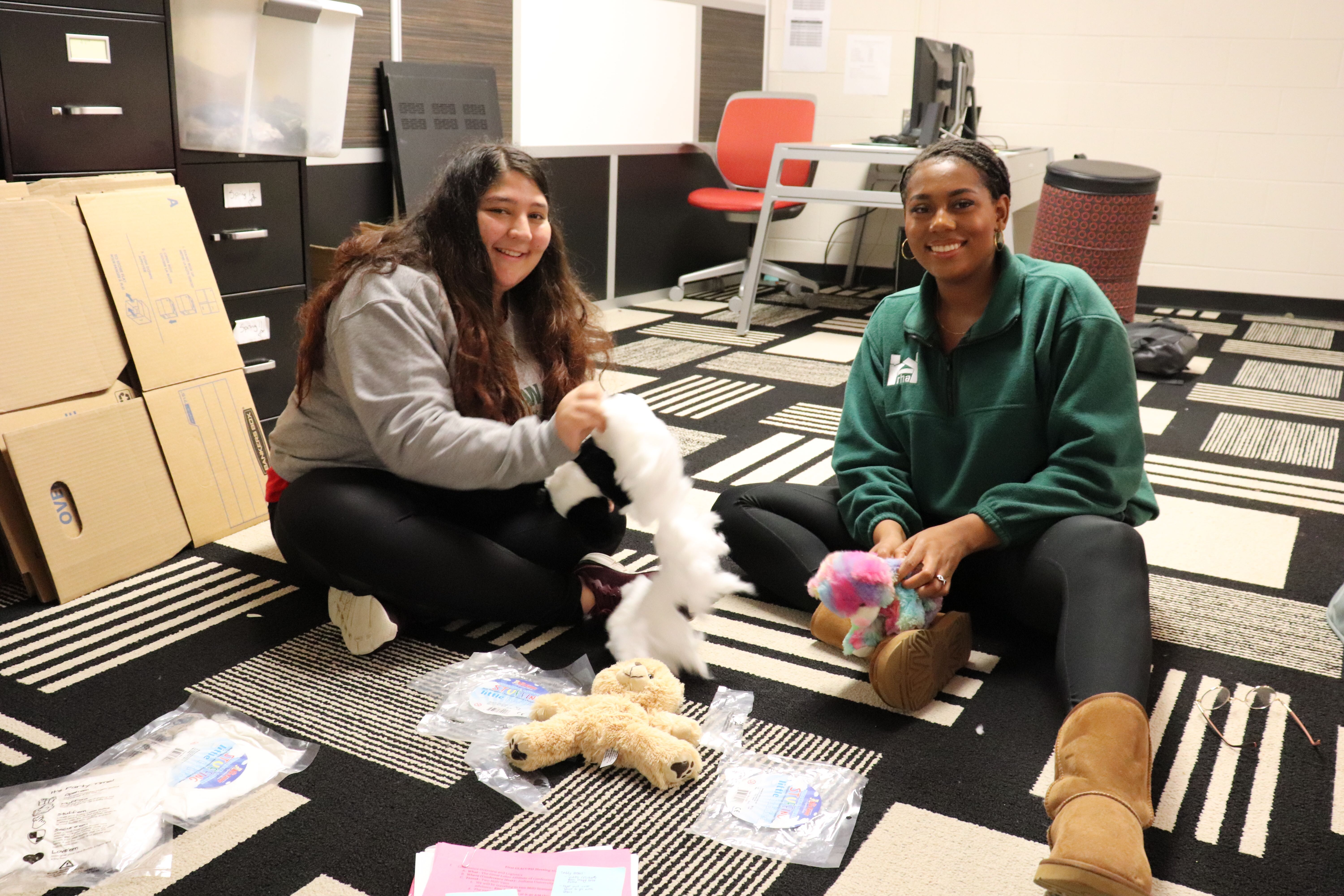 Selva (Chief of Staff) and Miyanna (President) stuffing bears at GLACURH